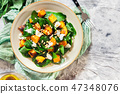 Roasted pumpkin salad with spinach and nuts 47348076