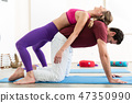 Couple practicing acroyoga 47350990