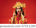 Chinese traditional woman. Beautiful young girl wearing in national costume 47351284