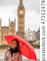 Woman Tourist Umbrella by Big Ben, London, England 47352478