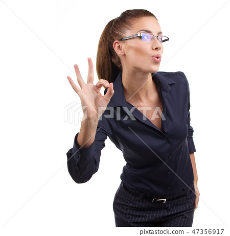 Happy smiling business woman with ok hand sign 47356917