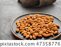 Assorted nuts in bowls on a black background. Copy space. 47358776
