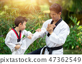 Boy and Dad enjoy healthy sport Taekwondo 47362549