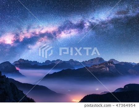 Milky Way above mountains in fog at night  47364954