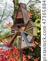 Birdhouses and a bird feeder 47365884