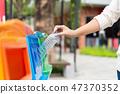 Closeup portrait woman hand throwing bottle 47370352