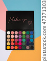 Makeup palette on a colorful geometrical background. 47371303