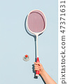 Woman's hand holding a retro badminton racket 47371631