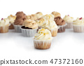 Frosted lemon cupcake in a close-up. 47372160