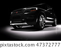 Front view of modern black SUV car in a spotlight 47372777