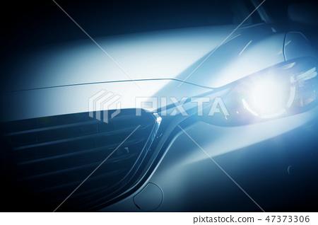 Modern luxury car close-up background 47373306