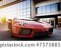 Red fast sports car in modern urban setting. Generic, brandless design 47373883