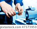 Man working on drilling and boring machine. Industry 47373950