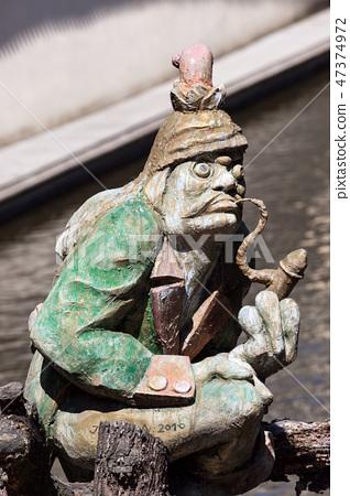The water goblin statue guarding Velkoprerovsky Mill on Certovka or Devil's stream. Prague, Czech Republic 47374972