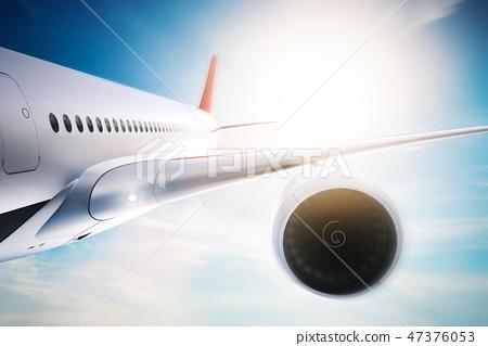 Passenger airplane flying at sunshine, blue sky. 47376053