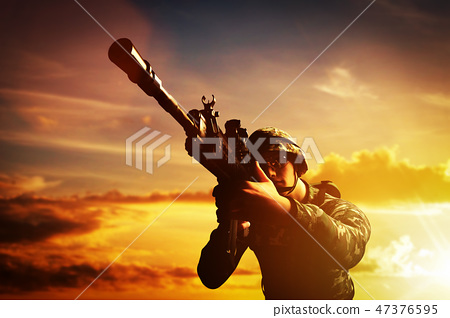 Soldier in combat shooting with his weapon, rifle. War, army concept 47376595