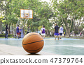 Basketball on the wooden chair. 47379764