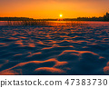 Landscape image of a sunset at winter with beautiful snow mounds 47383730
