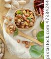 Seasoning fried peanut bean in basket, bean snack 47384244
