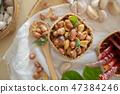 Seasoning fried peanut bean in basket, bean snack 47384246