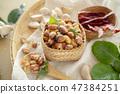 Seasoning fried peanut bean in basket, bean snack 47384251