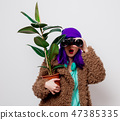 girl in jacket with binocular and plant 47385335