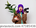 girl in jacket with binocular and plant 47385436