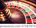 Roulette wheel in casino with ball. 47387674