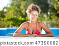 beautiful sexy female model posing by the pool, outdoor portrait 47390082