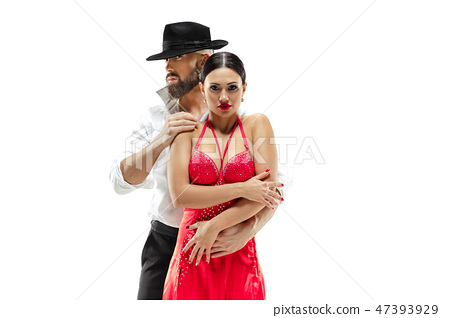 Portrait of young elegance tango dancers. Isolated over white background 47393929