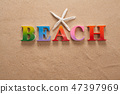 beach written in colorful letters on the beach 47397969