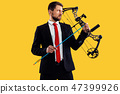 Businessman aiming at target with bow and arrow, isolated on yellow background 47399926