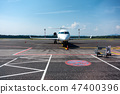 Small business, commuter jet airplane on airport 47400396