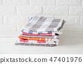 Kitchen towels or napkins in white kitchen. 47401976