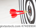Target dart arrow hitting in the center  47409904