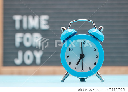 vintage blue alarm clock on the background 47415706