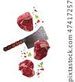 Raw marbled ribeye steak and butchers knife isolated 47417257