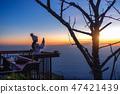 Woman taking photos of sunrise. 47421439