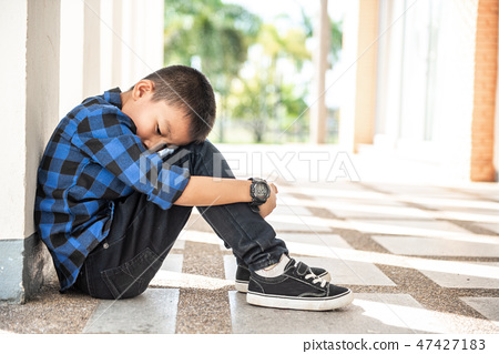Depressed asian boy. Young asian boy sad 47427183