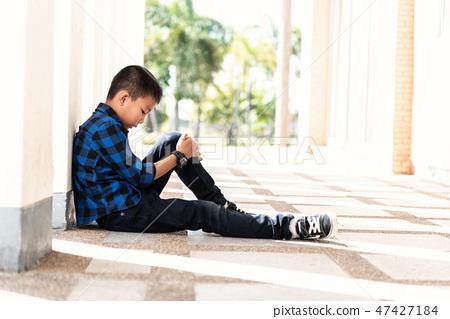 Depressed asian boy. Young asian boy sad 47427184
