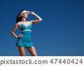 Girl in blue sports dress 47440424