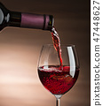 Wine pouring 47448627