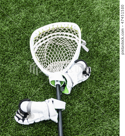 Lacrosse goalie stick with hgloves on turf field 47451580