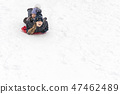 children slide on ice-boats 47462489