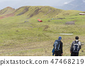 Hikers with backpack in foreground  47468219