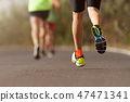 Runners feet running on road close up on shoe 47471341