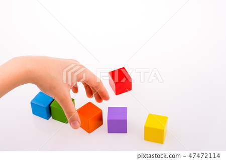 Hand playing with cubes 47472114