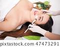 Beautiful woman with facial mask at beauty salon 47473291