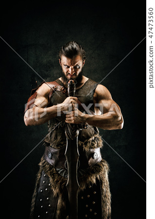 Portrait of a barbarian warrior 47473560