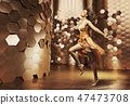 Dancing young woman wearing fabulous dress 47473708